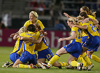 Sweden celebrates a 2-1 win over Canada to advance to the finals of the 2003 WWC.