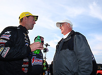 Feb 9, 2014; Pomona, CA, USA; NHRA pro stock driver Jason Line (left) is congratulated by NHRA official Graham Light as celebrates after winning the Winternationals at Auto Club Raceway at Pomona. Mandatory Credit: Mark J. Rebilas-