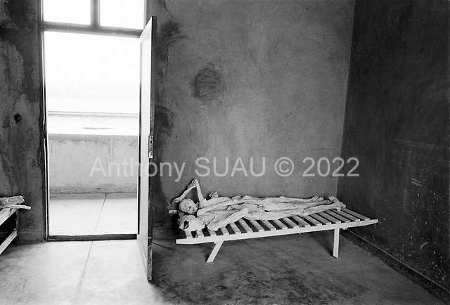 Gikongoro, Rwanda<br /> February 2004<br /> <br /> Skeletons of the people who died during the 1994 Rwandan genocide on display in a room at the Murambi Technical School, where nearly 50,000 ethnic Tutsis were killed in a period of 2 days. Some of the bodies were exhumed from the mass graves and placed on public display..