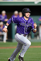 Third baseman Jake Crawford (19) of the Furman Paladins runs out a batted ball in a game against the Clemson Tigers on Tuesday, February 20, 2018, at Doug Kingsmore Stadium in Clemson, South Carolina. Clemson won, 12-4. (Tom Priddy/Four Seam Images)