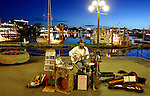 One-man band, Dave Harris, plays his blues music to passers-by on the Inner Harbour Causeway in Victoria, British Columbia. Harris, one of the West Coast's best bluesmen, has busked on the streets of Victoria for nearly 30 years.