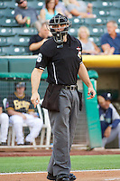 Home plate umpire Ryan Goodman looks to the dugout during a Pacific Coast League game between the Tacoma Raniers and the Salt Lake Bees  at Smith's Ballpark on July 8, 2014 in Salt Lake City, Utah.  (Stephen Smith/Four Seam Images)
