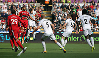 Federico Fernandez of Swansea City takes a header against Adrian Mariappa of Watford during the Premier League match between Swansea City and Watford at The Liberty Stadium, Swansea, Wales, UK. Saturday 23 September 2017