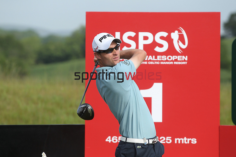 ISPS Handa Wales Open 2012.Welsh golfer Rhys Davies teeing off at the 1st hole in the Pro-Am tournament...30.05.12.©Steve Pope