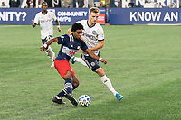FOXBOROUGH, MA - OCTOBER 19: DeJuan Jones #24 of New England Revolution crosses the ball in front of Kacper Przybylko #23 of Philadelphia Union during a game between Philadelphia Union and New England Revolution at Gillette on October 19, 2020 in Foxborough, Massachusetts.