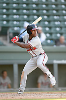 Shortstop Marcos Almonte (4) of the Rome Braves bats in Game 1 of a doubleheader against the Greenville Drive on Friday, August 3, 2018, at Fluor Field at the West End in Greenville, South Carolina. Rome won, 7-6. (Tom Priddy/Four Seam Images)