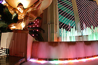 Fountains and pools below exterior of MGM Grand Hotel at night, Las Vegas, Clark County, N
