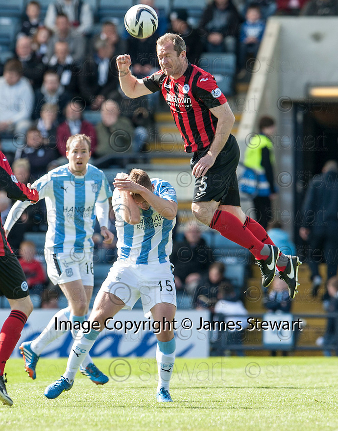 St Johnstone's Frazer Wright goes over the top of Dundee's Greg Stewart.
