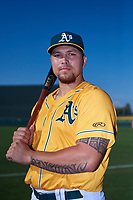 AZL Athletics Gold Gio Dingcong (14) poses for a photo before an Arizona League game against the AZL Rangers on July 15, 2019 at Hohokam Stadium in Mesa, Arizona. The AZL Athletics Gold defeated the AZL Rangers 9-8 in 11 innings. (Zachary Lucy/Four Seam Images)