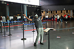 BROOKLYN, NY — OCTOBER 24, 2020:  A poll worker practices a tai chi stretching exercise for back pain relief inside the Barclay's Center, during the first day of early voting in the U.S. Presidential Election, on October 24, 2020 in Brooklyn, NY.  Photograph by Michael Nagle