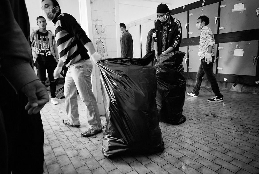 Bagged up body parts of suspected Gaddafi loyalists being dragged away in Benghazi, Libya.