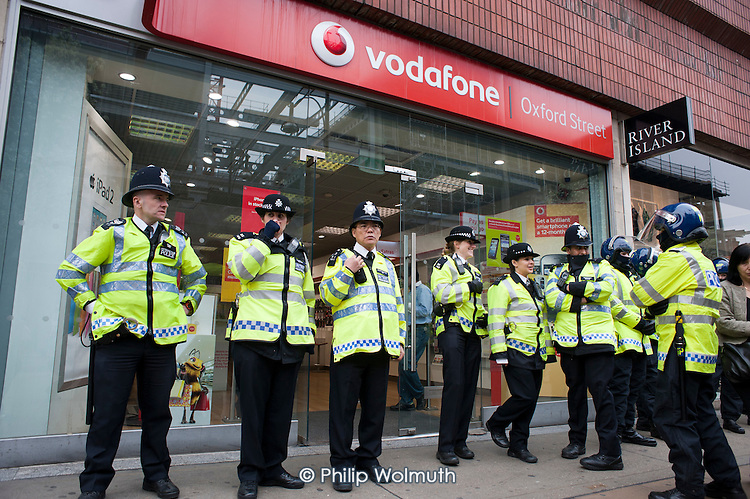 P{olice protect Vidaphone store in Oxford Street. TUC March for the Alternative, protest against public spending cuts, London.