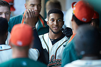 Lolo Sanchez (26) of the Greensboro Grasshoppers is congratulated by is teammates after hitting a three-run home run against the Hagerstown Suns at First National Bank Field on April 6, 2019 in Greensboro, North Carolina. The Suns defeated the Grasshoppers 6-5. (Brian Westerholt/Four Seam Images)