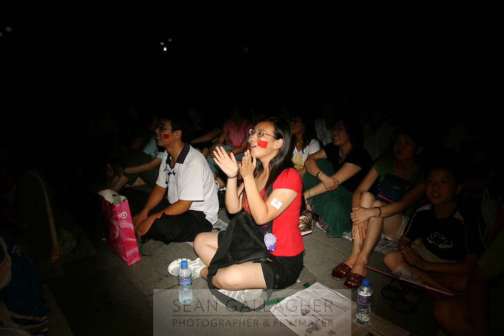CHINA. Beijing. Members of the public watching the opening ceremony of the Beijing 2008 Summer Olympics. 2008