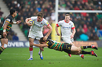 20121027 Copyright onEdition 2012©.Free for editorial use image, please credit: onEdition..Owen Farrell of Saracens is tackled by Dom Waldouck of Northampton Saints during the Aviva Premiership match between Northampton Saints and Saracens at Franklin's Gardens on Saturday 27th October 2012 (Photo by Rob Munro)..For press contacts contact: Sam Feasey at brandRapport on M: +44 (0)7717 757114 E: SFeasey@brand-rapport.com..If you require a higher resolution image or you have any other onEdition photographic enquiries, please contact onEdition on 0845 900 2 900 or email info@onEdition.com.This image is copyright the onEdition 2012©..This image has been supplied by onEdition and must be credited onEdition. The author is asserting his full Moral rights in relation to the publication of this image. Rights for onward transmission of any image or file is not granted or implied. Changing or deleting Copyright information is illegal as specified in the Copyright, Design and Patents Act 1988. If you are in any way unsure of your right to publish this image please contact onEdition on 0845 900 2 900 or email info@onEdition.com