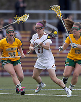 Boston College midfielder Kristin Igoe (21) shoots the ball. Boston College defeated University of Vermont, 15-9, at Newton Campus Field, April 4, 2012.