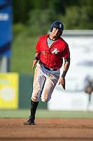 Antonio Rodriguez (6) of the Kannapolis Intimidators hustles towards third base against the Greensboro Grasshoppers at Intimidators Stadium on July 17, 2016 in Greensboro, North Carolina.  The Grasshoppers defeated the Intimidators 5-4 in game two of a double-header.  (Brian Westerholt/Four Seam Images)