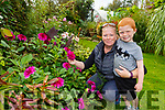 Barbara O'Connor and her nephew Denis Fleming in her garden in Farranfore