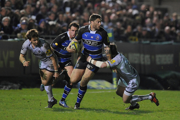 Matt Banahan of Bath Rugby is tackled during the LV= Cup semi final match between Bath Rugby and Leicester Tigers at The Recreation Ground, Bath (Photo by Rob Munro, Fotosports International)
