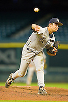 Relief pitcher J.T. Chargois #14 of the Rice Owls in action against the Baylor Bears at Minute Maid Park on March 6, 2011 in Houston, Texas.  Photo by Brian Westerholt / Four Seam Images