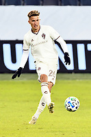 KANSAS CITY, KS - OCTOBER 24: Cole Bassett #26 Colorado Rapids with the ball during a game between  at Children's Mercy Park on October 24, 2020 in Kansas City, Kansas.