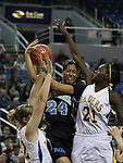 Foothill's Tanjunique Ajeto attempts a shot past Reed defenders during a semi-final game in the NIAA 4A State Basketball Championships between Reed and Foothill high schools at Lawlor Events Center in Reno, Nev, on Thursday, Feb. 23, 2012. .Photo by Cathleen Allison