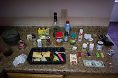Los Angeles, California<br /> January 28, 2014<br /> <br /> Former WWII homeless veteran Ivan Bennett 85 yrs old in a home he moved into 5 days ago. His food is laid out neatly on this kitchen counter top.