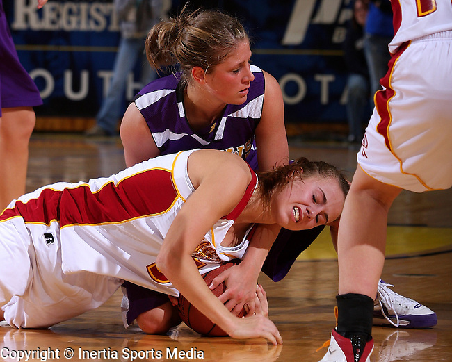 BROOKINGS, SD - March 12, 2009 : Rachel Soyland #5 of Roosevelt and Tara Heiser #12 of Watertown battle for a loose ball during the first half of their State Girls AA Tournament game at Frost Arena in Brookings. (Photo By Stephen Brua/ Inertia)