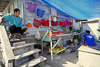 Native people sell fruits & hammocks in the streets of San Pedro on the island of Ambergris Caye, Belize. native vendors. San Pedro Ambergris Caye Belize Central America.