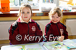 Leah Coffey Teehan and Aine Enright enjoying their first day back at school in Muire gan SmálNational School Castleisland on Monday.