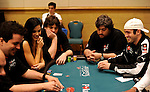 Playboy Playmate, Jayde Nicole (L), plays at the same table as 2009 World Champion Joe Cada (R) on   Day 1B of the 2010 PCA.