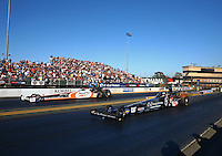 Jul. 26, 2013; Sonoma, CA, USA: NHRA top fuel dragster driver Bob Vandergriff Jr (near lane) races alongside teammate Clay Millican during qualifying for the Sonoma Nationals at Sonoma Raceway. Mandatory Credit: Mark J. Rebilas-