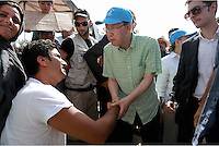 Pictured: Ban Ki-Moon speaks to a disabled migrant man at Kara Tepe in Lesbos, Greece. Saturday 18 June 2016<br /> Re: The United Nations secretary-general Ban Ki-moon has visited refugee camps on Lesbos island where 3,400 refugees and other migrants live.