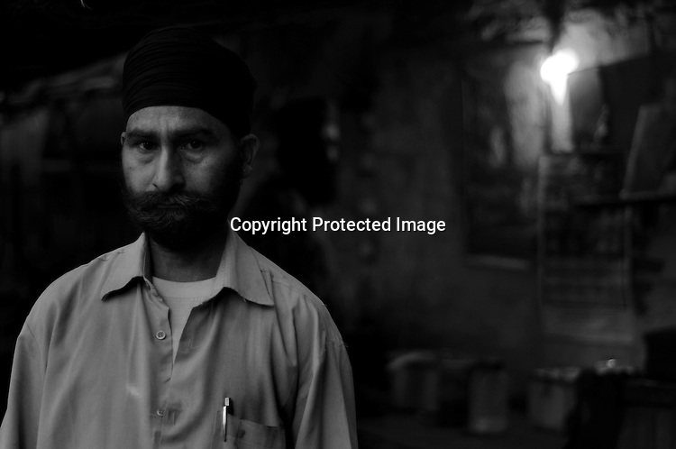 Kripal Singh who was bitten and was unconscious for 2 days lost his father and elder brother during the Sikh Genocide in 1984. Presently he runs a tea stall.  His son, accused of theft and now in jail, is a drug addict. Kirpal's son could never get the fatherly attention from Kirpal , busy earning a living for his big family, and thus easily got involved in bad company. Tilak Vihar in New Delhi is called the widow colony. Widows and children of the Sikhs who were killed in 1984 Sikh Genocide live here. Four thousand Sikhs were killed in 72 hours in Delhi alone but no body till date has been punished for such an inhuman crime. Illiteracy, drug addiction, child labour and immense poverty characterize the area. Twenty five years ago all the male family members above the age of 15 were killed and burnt, leaving their uneducated widows and children behind to suffer, even after 25 years. The present generation is jobless, steeped in alcoholism and have lost their directions in life. November 2009. New Delhi, India, Arindam Mukherjee