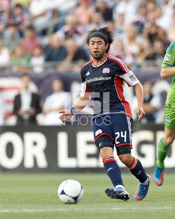 New England Revolution midfielder Lee Nguyen (24) short pass. In a Major League Soccer (MLS) match, the New England Revolution tied the Seattle Sounders FC, 2-2, at Gillette Stadium on June 30, 2012.