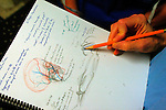 medical illustration student sketches details of a facial reconstruction surgery