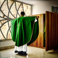 Father Pierre Salabert dresses himself in vestments before celebrating Mass at the Church of Guadelupe in Rome. Father Pierre is responsible for novices at the Maria Mater Ecclesiae International Pontifical College. The college which forms priests out of diocesan seminarians is operated by the Legionaries of Christ. The Legion of Christ is a conservative Roman Catholic congregation whose members take vows of chastity, obedience and poverty.