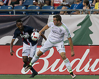 Foxborough, Massachusetts - May 28, 2016: First half action. In a Major League Soccer (MLS) match, the New England Revolution (blue/white) vs Seattle Sounders FC (white), 1-1 (halftime), at Gillette Stadium.
