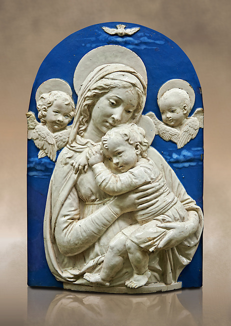 "Enamelled terracotta relief panel of the Virgin and Child with two cherubs a copy of the ""Madonna de l'Impuuneta"" by Luca della Robbia, Florence 1399-1482).  Inv Campana 32,  The Louvre Museum, Paris."
