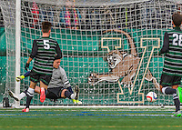 15 November 2015: Binghamton University Bearcat Goalkeeper Robert Moewes, a Junior from Dortmund, Germany, gives up the lone game goal to the University of Vermont Catamounts at Virtue Field in Burlington, Vermont. The Bearcats fell to the Catamounts 1-0 in the America East Championship Game. Mandatory Credit: Ed Wolfstein Photo *** RAW (NEF) Image File Available ***