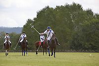 Italy. Tuscany. Polo Club Villa A Sesta is located near the village of Ripaltella and Pietraviva (Arezzo). Riccardo Tattoni is playing polo. He rides his horse while hitting the ball during polo game. The game is between the teams Villa A Sesta ( white, leaded by Ricardo Tattoni) and Los Nocheros (red). Riccardo Tattoni is the owner of Polo Club Villa A Sesta. 17.09.10 © 2010 Didier Ruef