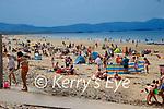 enjoying the sunshine at Banna Beach on Wednesday.