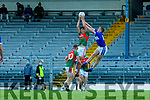 Paul O'Shea rises highest to claim the kickout ahead of Killian Spillane Templenoe