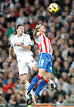 Real Madrid's Xabi Alonso against Atletico de Madrid's Raul Garcia La Liga match. November 07, 2010. (ALTERPHOTOS/Alvaro Hernandez).