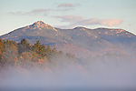 A foggy sunrise on Mount Chocorua over Silver Lake in Madison, NH, USA