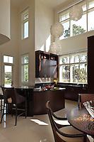 Modern guest kitchen with fun round lanterns