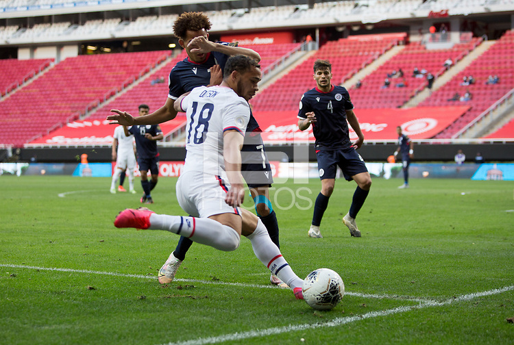 ZAPOPAN, MEXICO - MARCH 21: Hassani Dotson #18 of the United States passes off the ball during a game between Dominican Republic and USMNT U-23 at Estadio Akron on March 21, 2021 in Zapopan, Mexico.