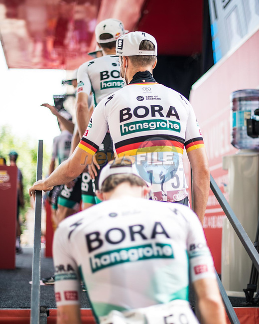 Bora-Hansgrohe at sign on before the start of Stage 6 of La Vuelta d'Espana 2021, running 158.3km from Requena to Alto de la Montaña Cullera, Spain. 19th August 2021.    <br /> Picture: Charly Lopez/Unipublic | Cyclefile<br /> <br /> All photos usage must carry mandatory copyright credit (© Cyclefile | Unipublic/Charly Lopez)