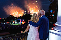 President Joe Biden and First Lady Jill Biden watch fireworks from the Blue Room Balcony of the White House, Sunday, July 4, 2021, during the Fourth of July celebration on the South Lawn. (Official White House Photo by Adam Schultz)