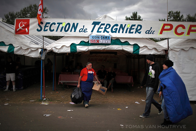 Concert goers walk past a tent run by a section of the French Communist Party at the  Fete de l'Humanite in La Courneuve, on the outskirts of Paris, France on 13 September 2009.
